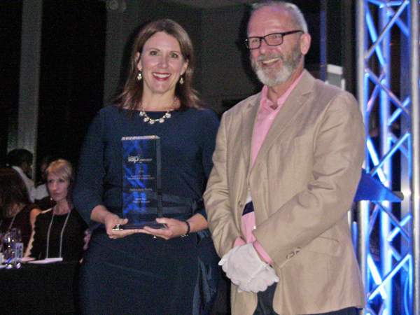 Lindsay Sutherland (Nova Scotia Health) receives Project of the Year Award from Bruce Gilbert